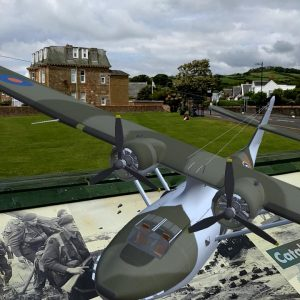 Close-up of model PBY Catalina flying above the panel installation of Largs D-Day Connection