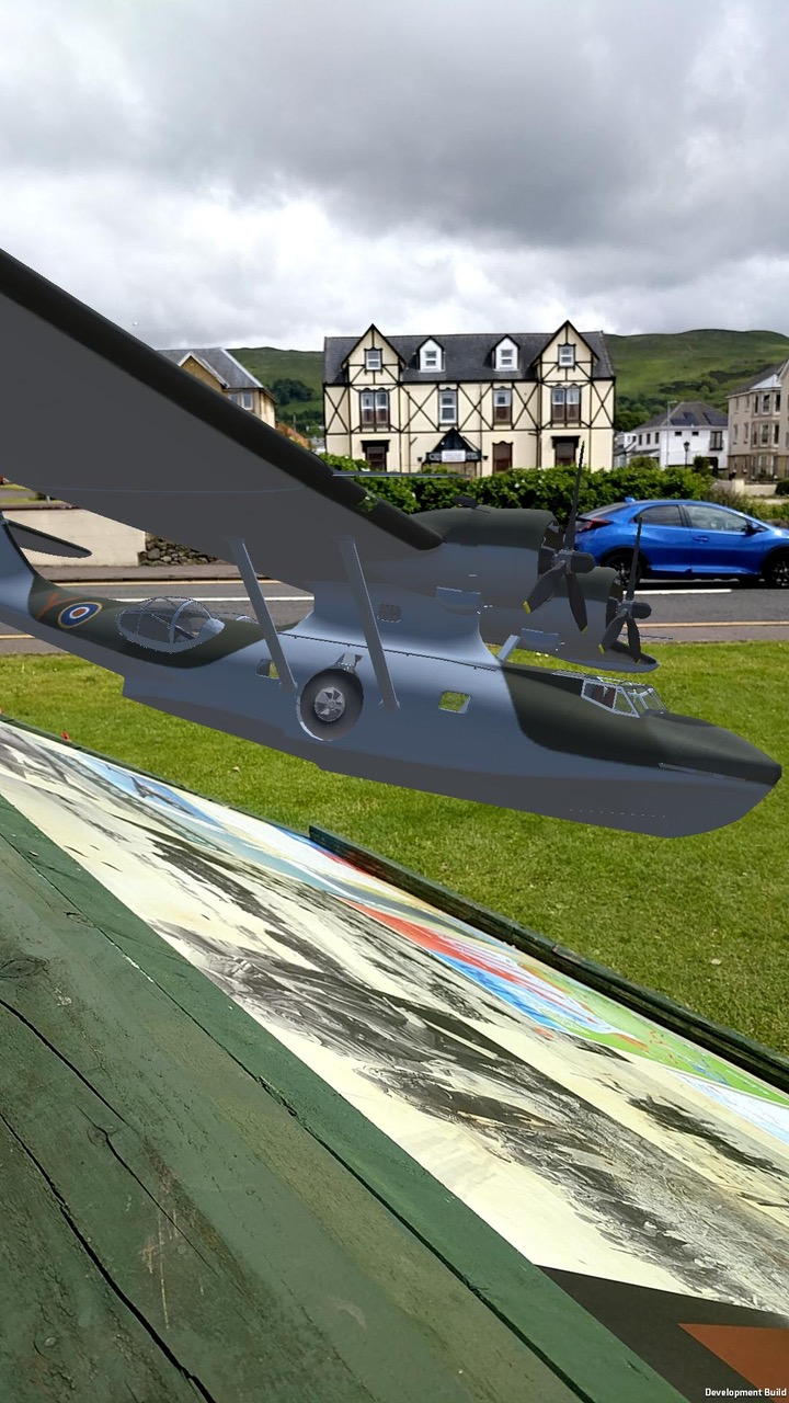 Side view of model PBY Catalina flying above the panel installation of Largs D-Day Connection