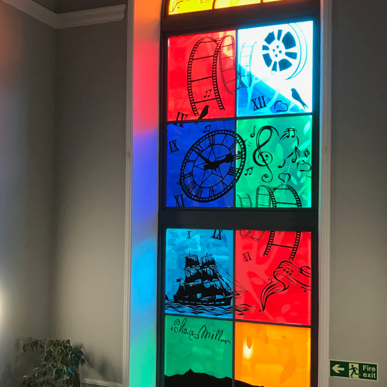 Custom vinyl used to create a stunning stained glass effect in Saltcoats Town Hall
