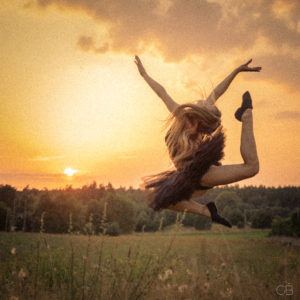 ballet dancer jumping at sunset