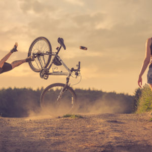 man falling off bike while looking at girl, conceptual photo