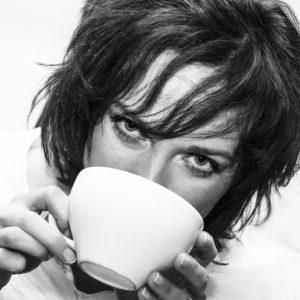 moody woman drinking coffee