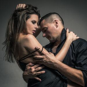 sexy couple embracing, studio portrait